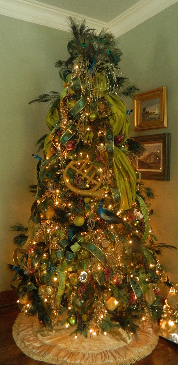 Include a few large ornaments to create a focal point and continue a theme for your Christmas tree.